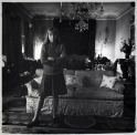 Penelope Tree in her living room, New York City, 1962  later gelatin silver print of Neil Selkirk 20 x 16 inch / 50.8 x 40.6 cm © Estate of Diane Arbus